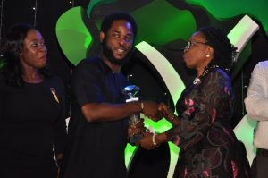 Head of Sponsorship, Airtel Nigeria, Opeyemi Lawal; Vice President, Brands and Advertising, Airtel Nigeria, Enitan Denloye while receiving the award for Campaign of the year from Iquo Ukoh at the ADVAN Awards for Marketing Excellence 2016.