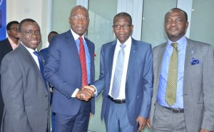 Deputy Managing Director, Stanbic IBTC Bank, Dr. Demola Sogunle; Founder and Executive Chairman, Zinox Technologies Ltd, Mr. Leo Stan-Eke; Chief Executive, Stanbic IBTC Bank, Mr. Yinka Sanni; and Executive Director, Personal and Business Banking, Stanbic IBTC Bank, Mr. Babatunde Macaulay; during the commissioning of Stanbic IBTC Bank's first digital branch located at Maryland Mall, Lagos on Wednesday, December 14, 2016,