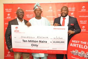 General Manager Mass Market Segment, Dipo Jolaosho; N10million grand prize winner, Oluwasegun Adesanya and Regional Operations Director, Lagos Region, Oladokun Oye at the Airtel Red Hot promo  prize presentation that held in Lagos on Wednesday, 21st of December, 2016.