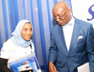 L-R: Executive Director Commercial, NASCON Allied Industries Plc, Fatima Dangote, discussing with another director of the company,  Prof. Chris Ogbechie at the company's Annual General Meeting (AGM) held recently in Lagos