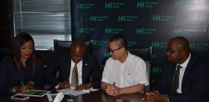 L-R: Mrs. Adaeze Udensi, Executive Director; Retail & SME Bank; Jude Monye, Executive Director, Business Banking; who both represented the MD/CEO of Heritage Bank Plc, Ifie Sekibo; General Manager, Biase Plantations Limited (BPL), Ahmad Mustaffa Goh and Corporate Affairs Manager, Antigha Essien Esiet, during the signing ceremony of N232million Pilot Out-growers' Agreement.