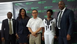 L-R Mr. Jude Monye, Executive Director Business Banking; Mrs. Adaeze Udensi, Executive Director; Retail & SME Bank; who both represented the MD/CEO of Heritage Bank Plc, Mr. Ifie Sekibo; the General Manager, Biase Plantations Limited (BPL), Mr. Ahmad Mustaffa Goh, Out-grower Officer BPL, Miss Solange Wankwi and Corporate Affairs Manager, Mr. Antigha Essien Esiet, at the signing ceremony of N232million Pilot Out-growers' Agreement between the Bank and Biase Plantations Limited at Heritage Bank's Head Office, Lagos.