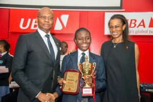 l-r:: GMD/CEO, United Bank for Africa (UBA) Plc, Mr. Kennedy Uzoka; Overall Winner of the 2017 UBA Foundation National Essay Competition and Student of British Nigerian Academy, Miss Samuella Sam-Orlu; and Managing Director/CEO, UBA Foundation, Bola Atta; during the Grand finale and prize giving ceremony of the UBA Foundation National Essay Competition,  held at UBA House in Lagos on Monday
