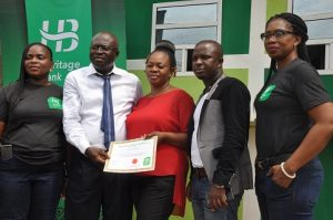L-R:  Zonal Head, South-West, Agent Banking, Heritage Bank, Oluwakemi Adewunmi; Managing Director, Dunmop Ventures/Agent, Mr Ayo Kale, his wife, Mrs OluwaKemi Kale; Managing Director, OC Ventures, Mr Hassan Azeez Olasukanmi, and Experience Centre Manager, Idumagbo, Nneoma Orji, during the inauguration of Heritage Bank in Lagos …yesterday